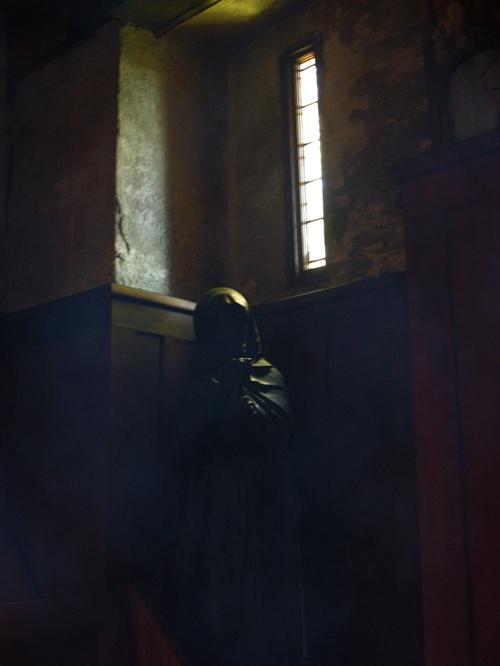 carved black wood statue in corner